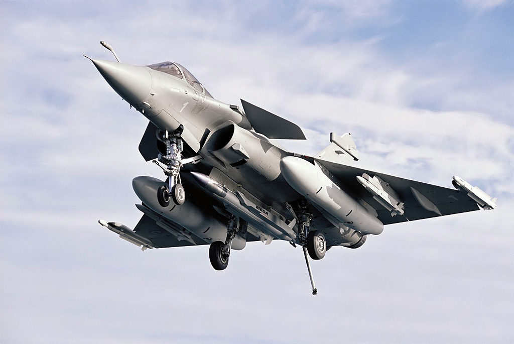 Rafale N carrying ASMP missile landing on the Charles De Gaulle aircraft carrier.