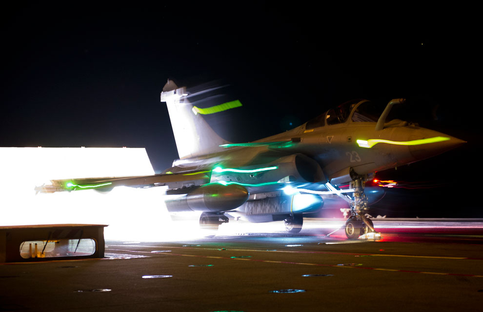 Rafale fighter ready to take-off from aircraft carrier with a Scalp missile.