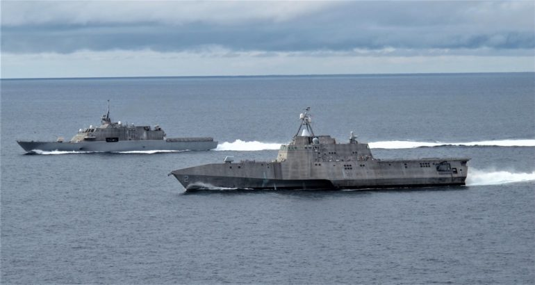 littoral combat ships USS Freedom (LCS 1), left, and USS Independence (LCS 2)