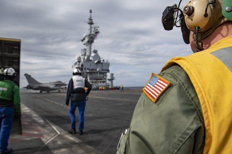 U.S. Navy Landing signal officer (LSO) aboard Charles de Gaulle.