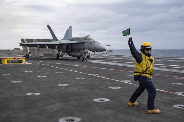 U.S. Navy F/A-18E Super Hornet about to launch from French aircraft carrier Charles de Gaulle.