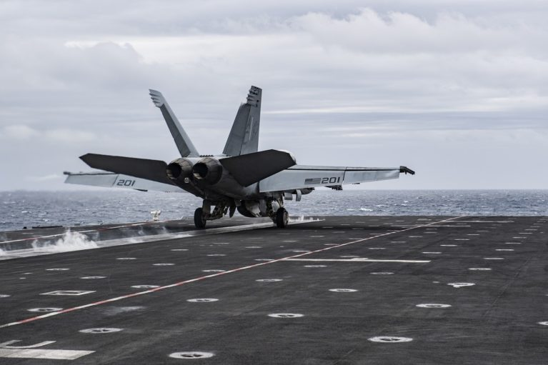 U.S. Navy F/A-18E Super Hornet launching from French aircraft carrier Charles de Gaulle.