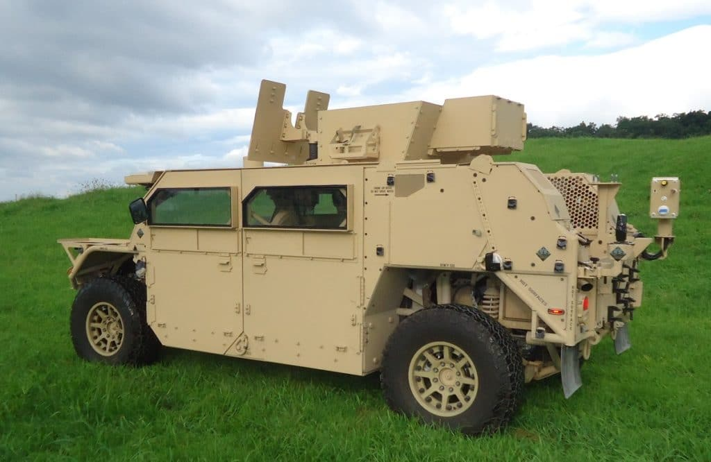 A SOCOM GMV 1.1 up-armored with crew protection armor and turret armorpackage.