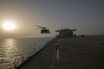 US Army AH-64E helicopters complete deck-landing qualifications aboard USS Lewis B Puller