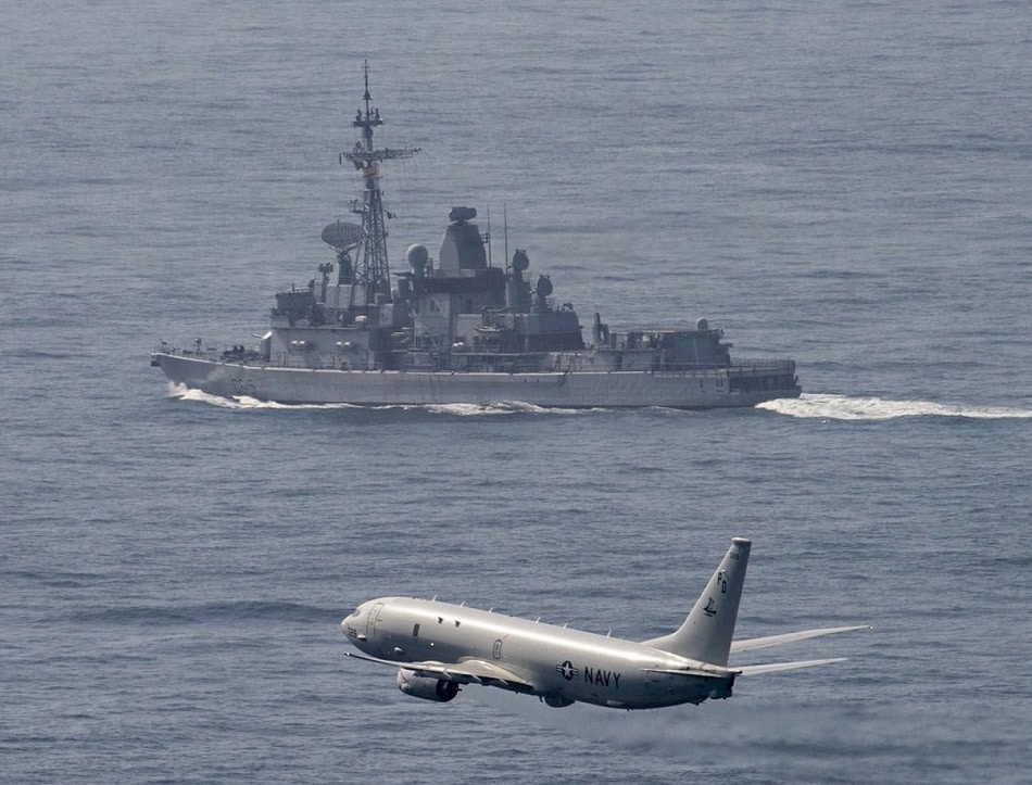 A U.S. Navy P-8 Poseidon flies alongside the Marine Nationale anti-air destroyer FS Jean Bart (D 615) while transiting the Strait of Gibraltar, May 3, 2019. (U.S. Navy by MCS 3C Connor D. Loessin)