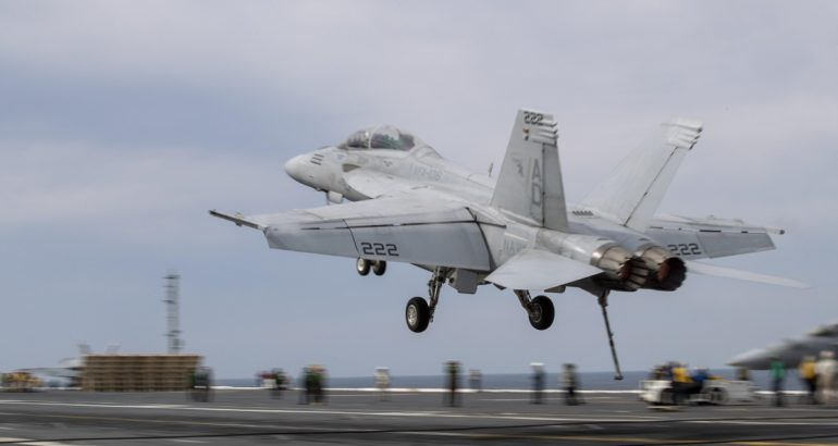 F/A-18F Super Hornet uses its tail hook to catch the Advanced Arresting Gear on the flight deck of USS Gerald R. Ford (CVN 78) during flight operations March 27.