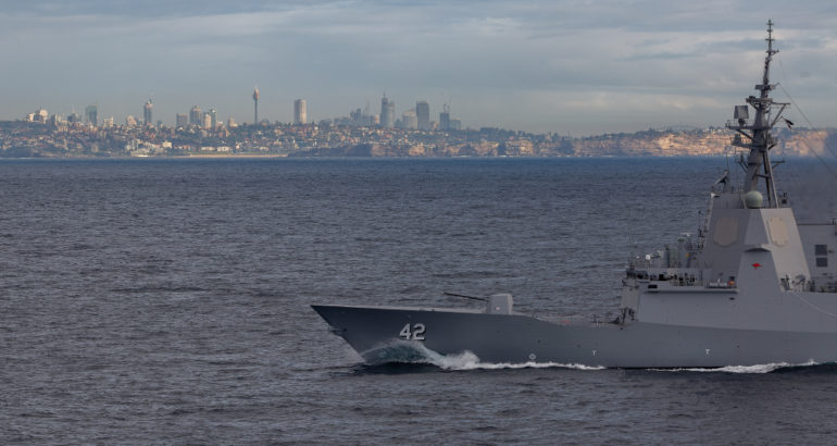 HMAS Sydney off the NSW coast during her commissioning ceremony.