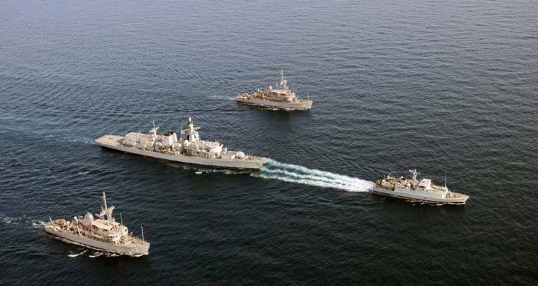 HMS Shoreham leads frigate HMS Argyll, flanked by American minehunters USS Dextrous (nearest the camera) and USS Gladiator. Royal Navy Picture