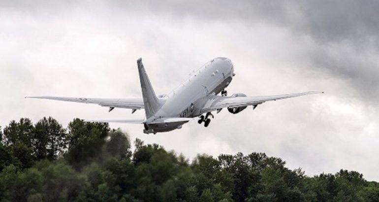 The 100th P-8A Poseidon built for the U.S. Navy departs Boeing Field. (Boeing photo)