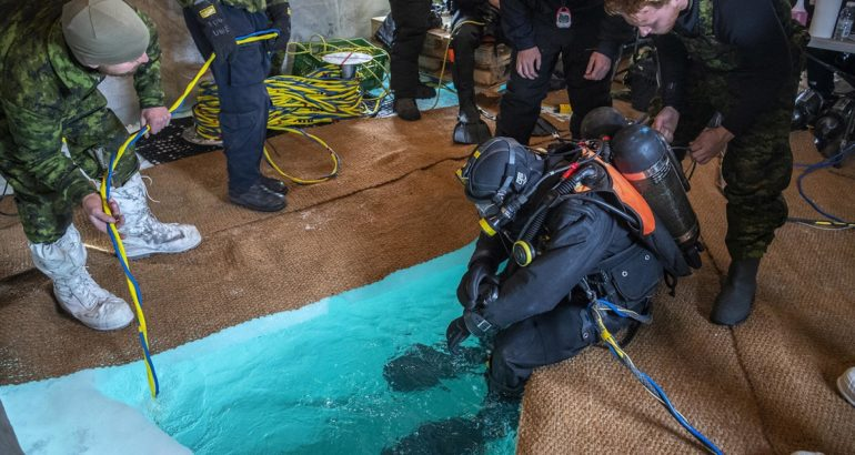 Fleet Diving Unit Atlantic members prepare to conduct their first dive at the Rankin Inlet dive site during Operation NANOOK-NUNALIVUT 2020, on March 12, 2020.