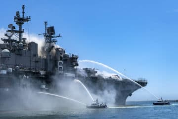 Firefighters continue to battle fire aboard USS Bonhomme Richard amphibious assault ship