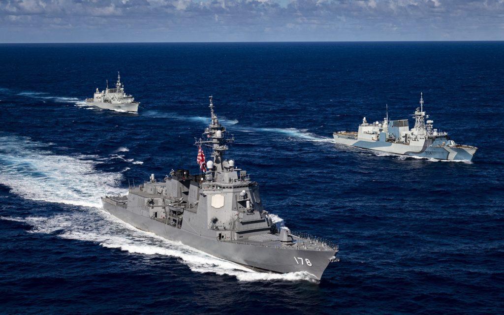 JMSDF Destroyer JS Ashigara sailing alongside two Royal Canadian Navy Halifax-class frigates