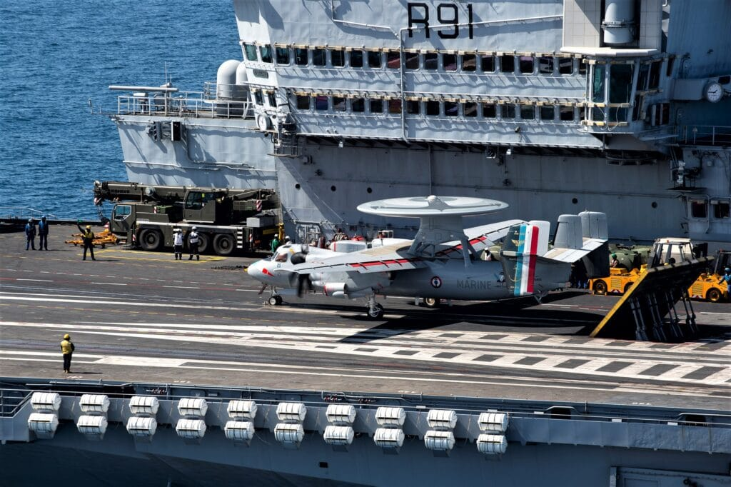 An E-2C Hawkeye on the flight deck of the aircraft carrier Charles de Gaulle ready for catapulting.