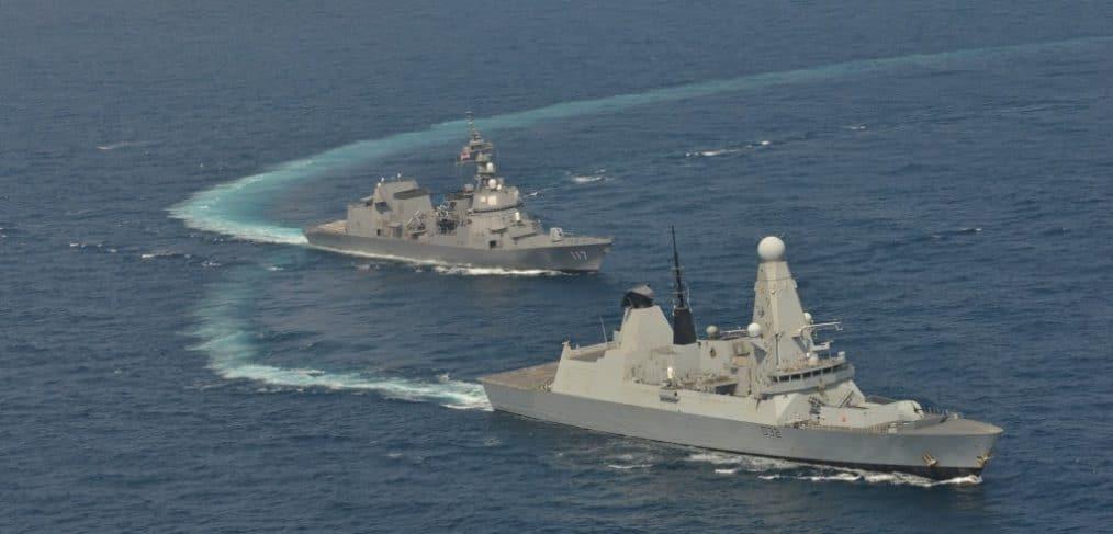 Royal Navy destroyer HMS Daring sailing alongside JMSDF destroyer JS  Suzutsuki
