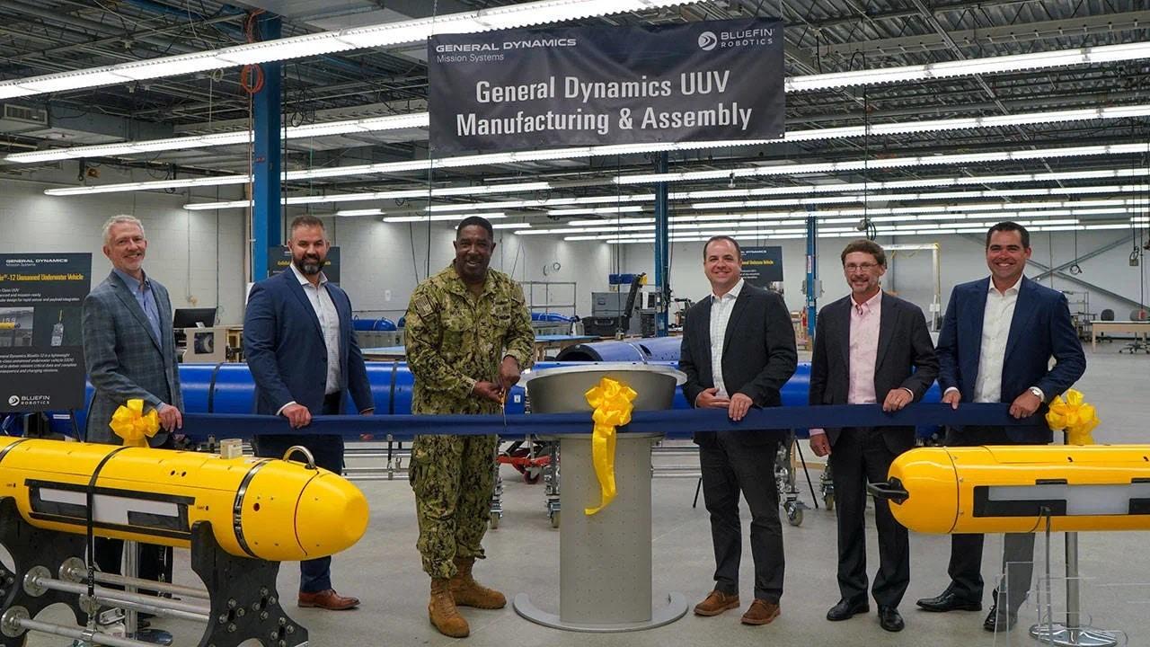 https://www.navalnews.com/wp-content/uploads/2021/08/Taunton-UUV-Manufacturing-Ribbon-Cutting.jpg