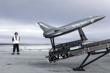 Royal Navy Aircraft Carrier Launches Drones during landmark demo
